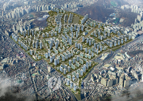 This aerial view released in February 2008 shows how the redevelopment project is supposed to change Jangwi-dong. (Yonhap)