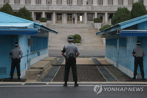 North Korean guards standing face-to-face at the Joint Security Area, a small strip of land in the truce village of Panmunjom