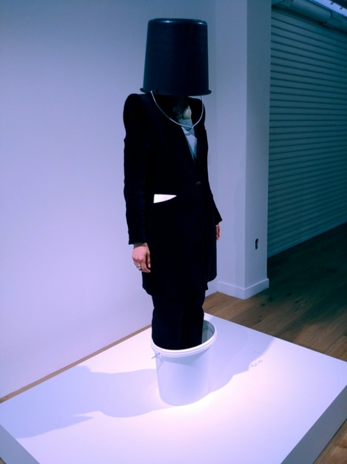 """A visitor participates in Erwin Wurm's """"One Minute Sculpture"""" series at Hyundai Card Storage in Itaewon, central Seoul, on April 18, 2018. (Yonhap)"""