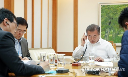 Korea's presidential office Cheong Wa Dae President Moon Jae-in is seen holding a telephone conversation with his U.S. counterpart Donald Trump
