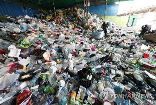 This file photo, taken April 2, 2018, shows plastic waste stacked at a recycling center in Yongin, 50 kilometers south of Seoul. (Yonhap)