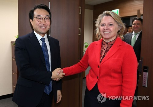 24 2018 Lee Do-hoon, South Korea's representative for Korean Peninsula peace and security affairs shakes hands with Susan Thornton acting U.S. assistant secretary of state for East Asian and Pacific Affairs