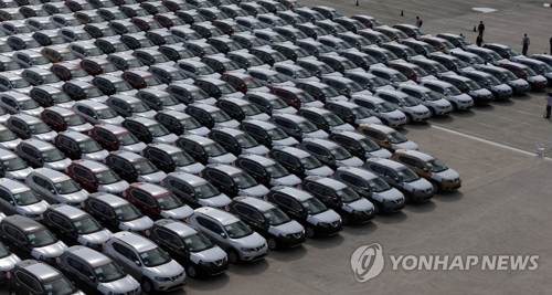 This undated photo shows Nissan Motor's Rogue SUVs lined up at a local port ready for export. (Yonhap)