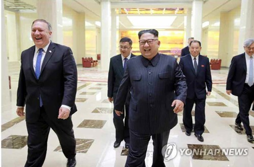 North Korean leader Kim Jong-un (R) meets U.S. Secretary of State Mike Pompeo (L) in this photo published in the May 10, 2018, edition of the North's daily Rodong Sinmun. (For Use Only in the Republic of Korea. No Redistribution) (Yonhap)