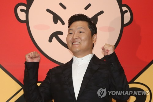 """South Korean singer Psy poses for a photo during a publicity event in Seoul on May 10, 2017, to unveil his eighth album featuring 10 songs, including the title track """"New Face"""" and the first track """"I Luv It."""" (Yonhap)"""