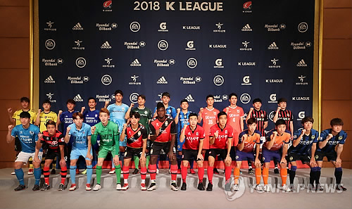 In this file photo taken on Feb. 27, 2018, players from K League 1 clubs pose for a photo during a media event in Seoul. (Yonhap)