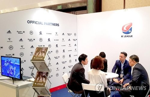 This undated photo provided by the K League shows its officials meeting with customers at SPORTELAsia, a sports marketing and media convention in Singapore. (Yonhap)
