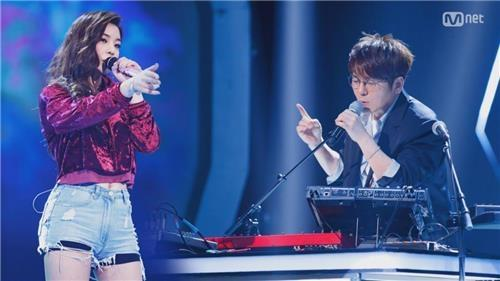 This image provided by Mnet shows the collaboration between Ailee (L) and Shin Seung-hoon. (Yonhap)