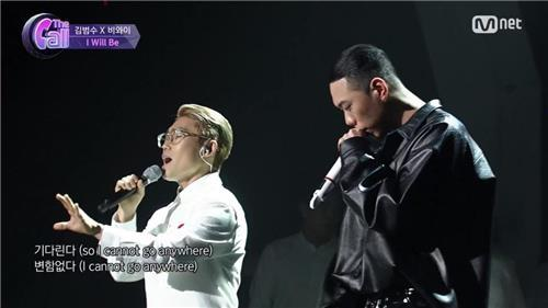 This image provided by Mnet shows the collaboration between Kim Bum-soo (L) and BewhY. (Yonhap)