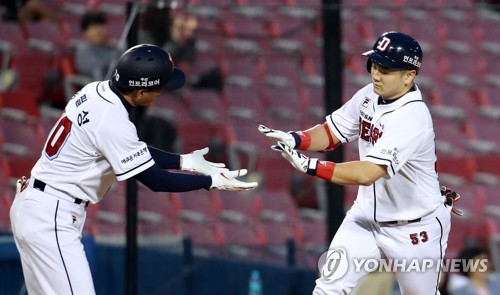 In this file photo from May 11, 2018, Choi Joo-hwan of the Doosan Bears (R) celebrates his two-run home run against the Nexen Heroes with his third base coach Kong Pill-sung during a Korea Baseball Organization regular season game at Jamsil Stadium in Seoul. (Yonhap)
