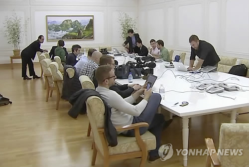 Foreign reporters prepare to cover North Korea's nuclear test site dismantlement at a hotel in Wonsan