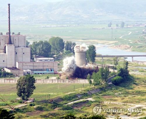 North Korea blows up a cooling tower at its Yongbyon nuclear complex in this 2008 file photo. (Yonhap)