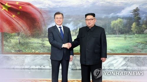 This image shows summit talks between South Korean President Moon Jae-in and North Korea's leader Kim Jong-un. (Yonhap)