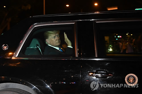 U.S. President Donald Trump heads to the Shangri La Hotel in Singapore after arriving in the country
