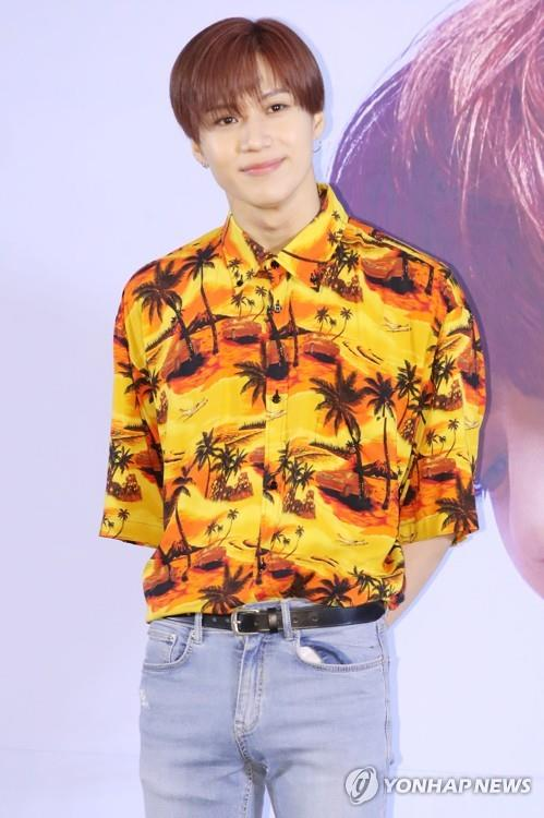 SHINee member Taemin poses for photos during a press conference on June 11, 2018. (Yonhap)