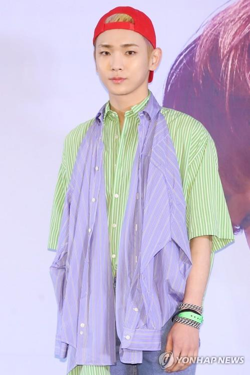 SHINee member Key poses for photos during a press conference in Seoul on June 11, 2018. (Yonhap)