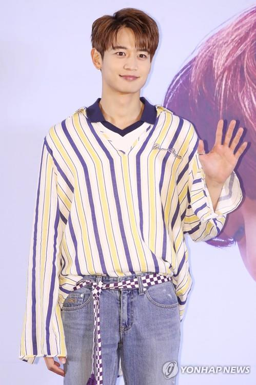 SHINee member Minho poses for photos during a press conference in Seoul on June 11, 2018. (Yonhap)