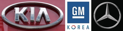 Corporate logos of Kia, GM Korea and Mercedes-Benz (Yonhap)