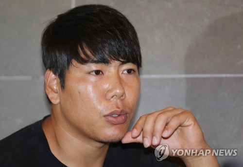 In this file photo from Sept. 19, 2017, Kang Jung-ho, South Korean infielder in the Pittsburgh Pirates organization, speaks to Yonhap News Agency in an interview in Gwangju, 330 kilometers south of Seoul. (Yonhap)