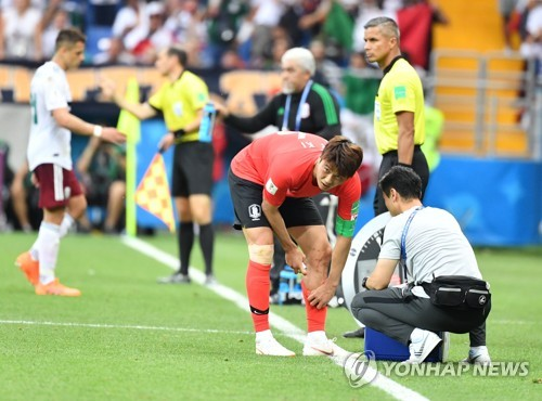 South Korea's Ki Sung-yueng receives medical treatment during the 2018 FIFA World Cup Group F match between South Korea and Mexico at Rostov Arena in Rostov-on Don