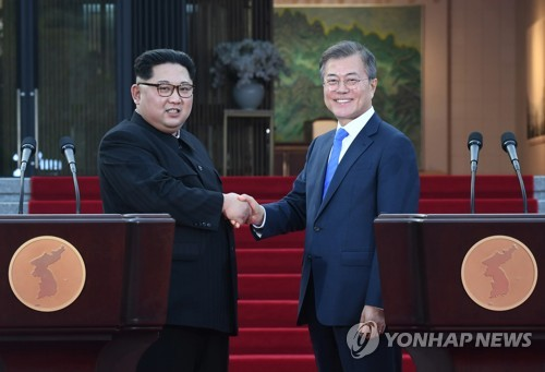 In this file photo, taken April 27, 2018, South Korean President Moon Jae-in (R) and North Korean leader Kim Jong-un are seen shaking hands after a joint press conference to announce the outcome of their historic summit held in the border village of Panmunjom on the inter-Korean border. The two leaders of the divided Koreas met again in Panmunjom on May 26, 2018, for their second bilateral summit -- the fourth inter-Korean summit in history. (Yonhap)