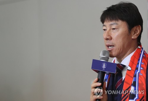 In this file photo from June 29, 2018, South Korean men's national football head coach Shin Tae-yong speaks to reporters at Incheon International Airport after returning from the FIFA World Cup in Russia. (Yonhap)