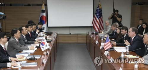 South Korean and U.S. officials hold talks in Seoul on sharing the cost of maintaining American troops in Korea on June 26, 2018. (Yonhap)
