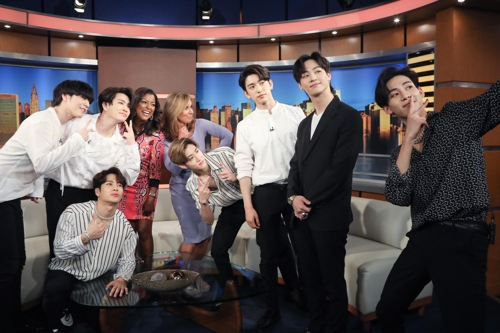 This photo of GOT7 members posing for a photo with emcees of