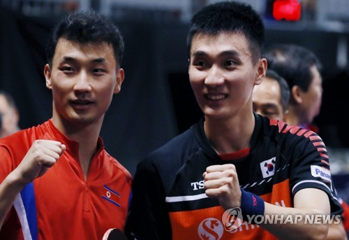 Unified korean doubles teams experience different fates at - International table tennis federation ittf ...