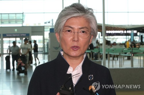 Foreign Minister Kang Kyung-wha speaks to the press before departing for Singapore at Incheon International Airport, west of Seoul, on July 31, 2018. (Yonhap)