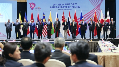 The foreign ministers of the ASEAN Plus Three member states pose for