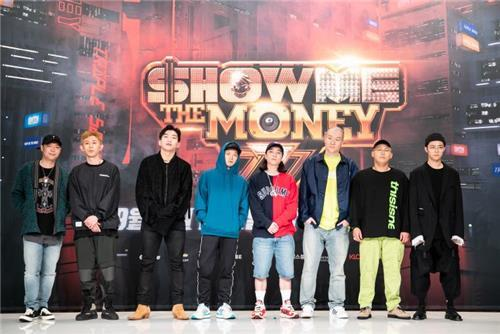 """This image provided by Mnet shows the panel of eight judges for the seventh season of the rap competition show """"Show Me the Money."""" (Yonhap)"""