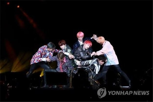This image shows K-pop band BTS giving a performance. (Yonhap)
