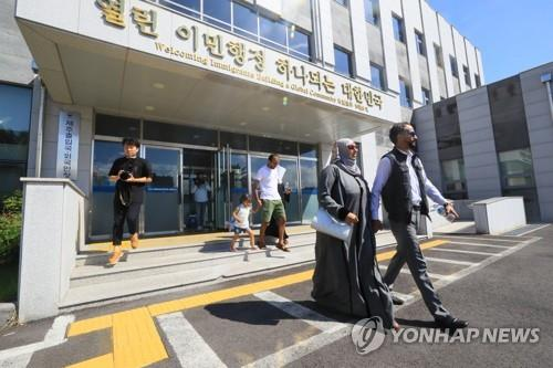 Unidentified Yemeni asylum seekers leave the immigration office on the southern island of Jeju after receiving humanitarian stay permits on Sept. 14, 2018. (Yonhap)