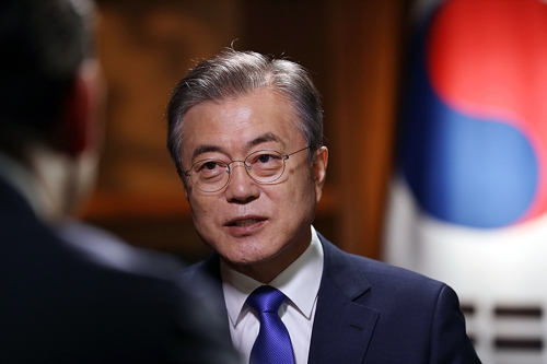 In the photo, provided by South Korea's presidential office Cheong Wa Dae, South Korean President Moon Jae-in is seen holding an interview with a local U.N. news network in New York on Sept. 25, 2018. (Yonhap)
