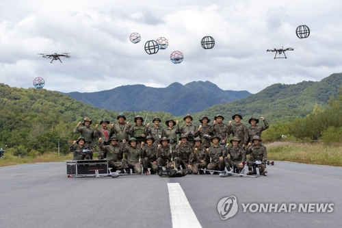 This undated photo, provided by the Army, shows service members of South Korea's first drone combat unit. (Yonhap)