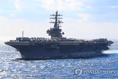 The nuclear-powered aircraft carrier USS Ronald Reagan joins South Korea's once-in-a-decade international fleet review in waters off the southern island of Jeju on Oct. 11, 2018. (Yonhap)