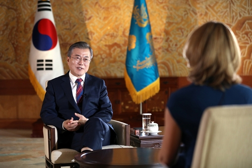 South Korean President Moon Jae-in (L) is interviewed by Britain's BBC news at his office Cheong Wa Dae in Seoul on Oct. 12, 2018, in this photo released by Cheong Wa Dae. (Yonhap)