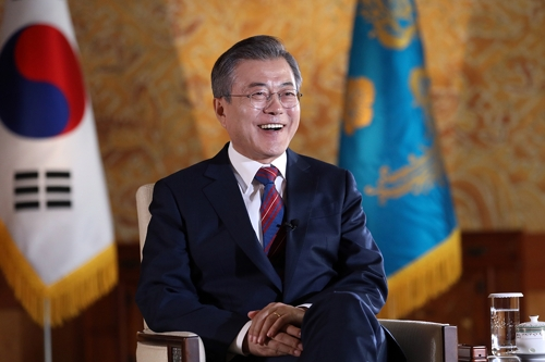 In this photo provided by his office Cheong Wa Dae, South Korean President Moon Jae-in is seen smiling during an interview with a British news channel at his office on Oct. 12, 2018, one day before he was set to embark on a four-nation Europe tour. (Yonhap)