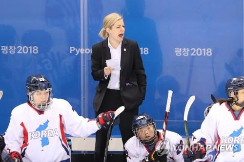 Players' discontent forces hockey coach out: sources