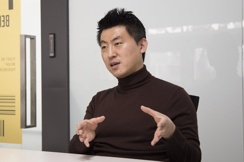 In this photo, provided by Yanolja Co., its chief business officer Kim Jong-yoon speaks during an interview with Yonhap News Agency at its headquarters in Seoul on Oct. 22, 2018. (Yonhap)