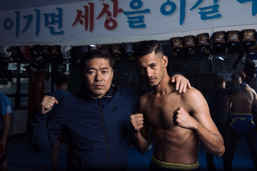 Ahmed Askar, a 28-year-old Yemeni kick boxer, poses with his Korean coach in this photo provided by him. (Yonhap)