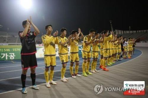 This undated photo provided by the K League shows Asan Mugunghwa FC players. (Yonhap)