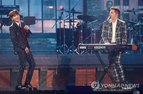 BTS performs with American singer-songwriter Charlie Puth during the 2018 MBC Plus X Genie Music Awards in Incheon, west of Seoul, on Nov. 6, 2018. (Yonhap)
