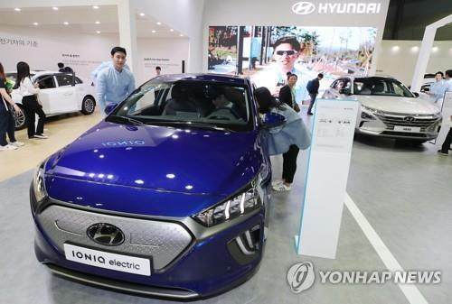 Sales of eco-friendly cars jump 30 pct through June