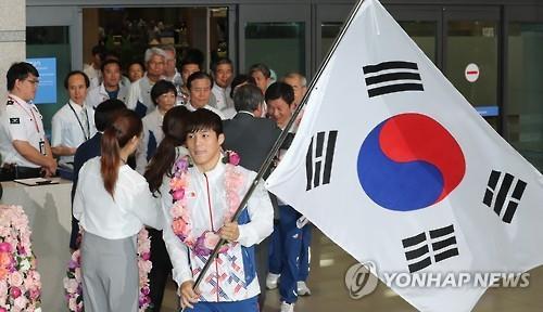 リオ五輪の韓国選手団が帰国 解団式で成績報告