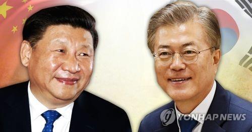 習主席(左)が文大統領に韓中関係発展へのメッセージを送った(イメージ)=(聯合ニュース)