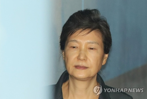 裁判所に出廷する朴槿恵被告=(聯合ニュース)