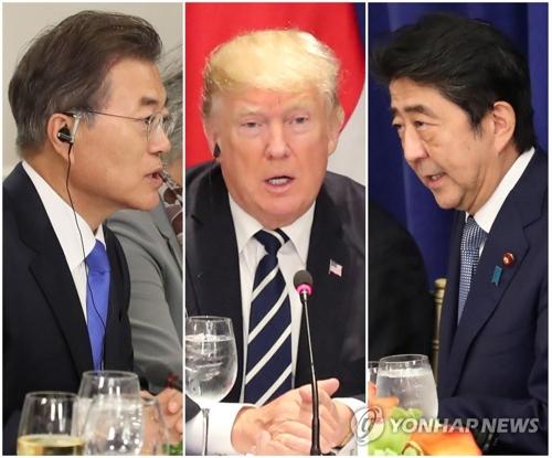 9月にニューヨークで昼食を交えて首脳会談を行った(左から)文大統領、トランプ大統領、安倍首相=(聯合ニュース)
