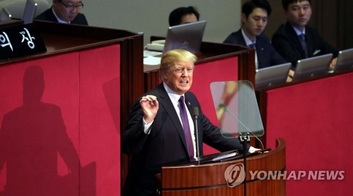 韓国国会で演説するトランプ氏=8日、ソウル(聯合ニュース)